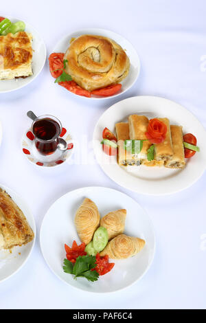 Homemade rolled borek, pastry, Turkish patty with tea - Stock Photo