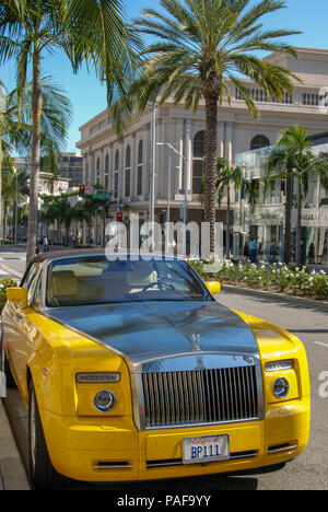 Yellow Rolls Royce car parked on Rodeo Drive, Beverley Hills, California. - Stock Photo