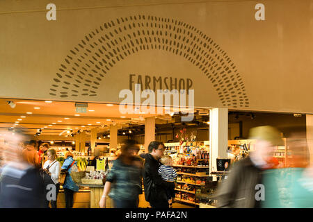 Interior view of entrance to the farm shop in the M5 motorway services in Gloucester. Slow shutter speed to blur the motion of visitors. - Stock Photo