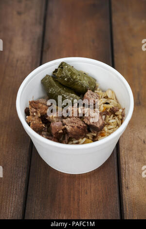 Soft focus photo of dolma and fried meat in take away plate - Stock Photo
