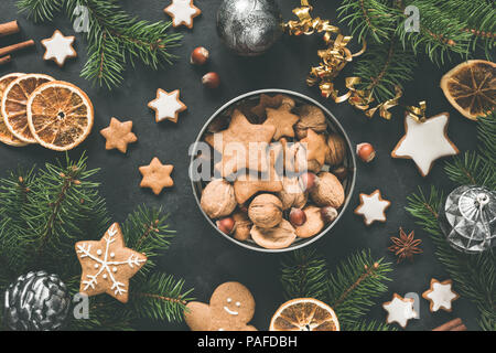 New Year or Christmas box with sweets Gingerbread cookies, gingerbread stars, dried orange rings and fir tree. Top view. Christmas flat lay compositio - Stock Photo