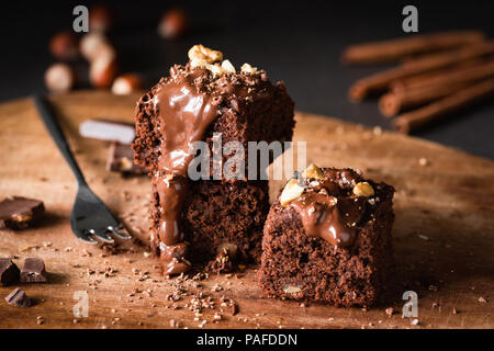 Chocolate Cake Brownie Squares With Chocolate Glaze and Walnuts. Closeup view, selective focus - Stock Photo