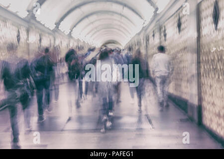 Unrecognizable group of walking people in subway station. Blurred abstract motion background, violet shades - Stock Photo