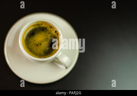 black coffee in a ceramic cup on the bar, energy drink in a public place, cafe - Stock Photo