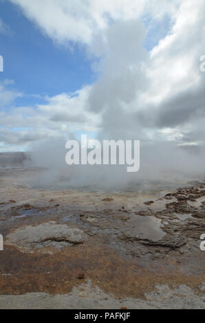 Strokkur geyser steaming after geothermal activity. - Stock Photo