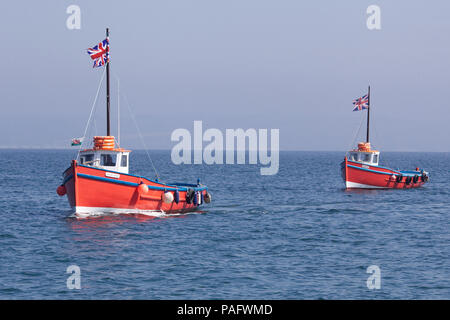 sightseeing boats out on the ocean - Stock Photo