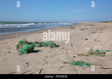Discarded plastic fishing nets washed-up on beach, Tanji, The Gambia - Stock Photo