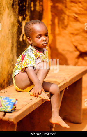 KARA, TOGO - MAR 11, 2012:  Unidentified Togolese boy watches the religious voodoo dance. Voodoo is the West African religion - Stock Photo
