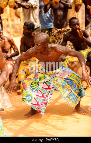 KARA, TOGO - MAR 11, 2012:  Unidentified Togolese man dances the religious voodoo dance. Voodoo is the West African religion - Stock Photo