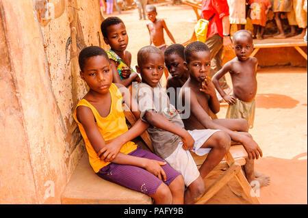 KARA, TOGO - MAR 11, 2012:  Unidentified Togolese children watch the religious voodoo dance. Voodoo is the West African religion - Stock Photo