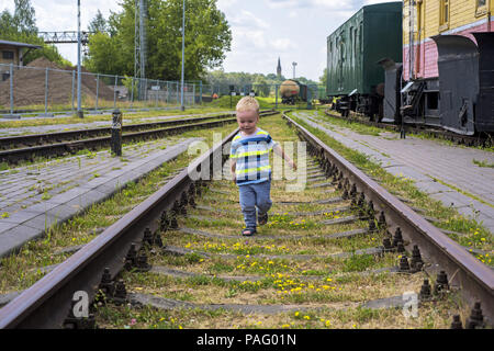 Small boy on railway rails.Sunny summer day. - Stock Photo