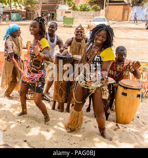 ANGOLA, LUANDA - MARCH 4, 2013:  Unidentified Angolan women make the street performance of the national falk dance for the tourists in Angola, Mar 4,  - Stock Photo