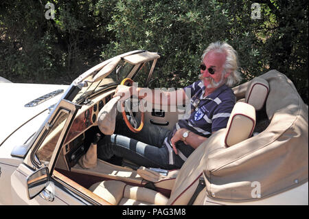 The owner of a wonderful two seater sports car, the 2.8 Ltr Panther Kallista seen here climbing the small hills around the beautiful area of Languedoc - Stock Photo