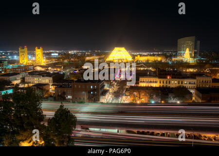 An elevated view of the riverfront in Sacramento, California at Christmas with I5 in the foreground and the Ziggurat in the background - Stock Photo