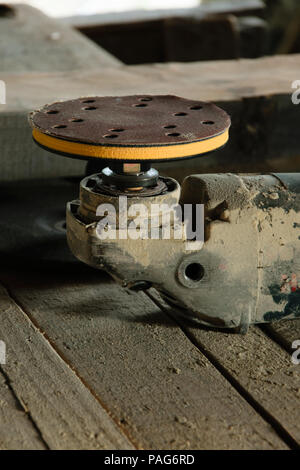 Close up of electric sander in the workshop - Stock Photo