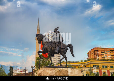 Monument of Skanderbeg in Scanderbeg Square in the center of Tirana city, Albania against a cloudy sky. Tirana is the capital of Albania. - Stock Photo