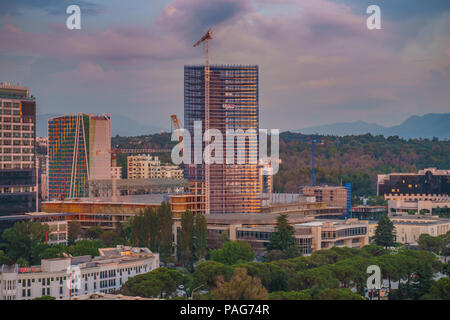 Areal cityscape view of Tirana city center at sunset. Modern Architectural buildings and urban photography in Tirana, the capital of Albania. - Stock Photo
