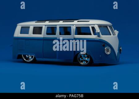 mini van transportation toy on blue background - Stock Photo