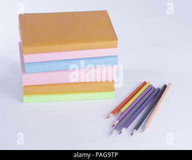 colored pencils and stack of books on white background. photo wi - Stock Photo