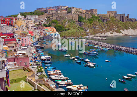 The fishing village Procida with fishing harbour Marina di Corricella and fortress Terra Murata, a former prison, Gulf of Naples, Italy - Stock Photo