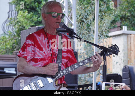 Los Angeles, CA / USA - July 22, 2018: Robby Krieger, original guitarist for The Doors, performs at the 6th annual Love Street Festival in the Laurel Canyon section of the city. Singer Jim Morrison wrote the lyrics to the song 'Love Street' about the area and, commemorating the 50th anniversary of the song's release, the city of L.A. renamed a portion of the street Morrison lived on in the 1960s, Rothdell Trail, to Love Street. - Stock Photo