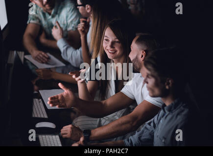 creative business team works overtime - Stock Photo