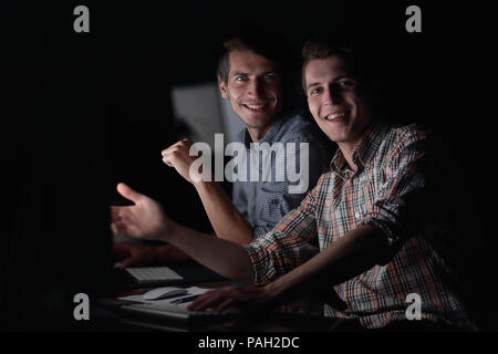 business colleagues working late - Stock Photo