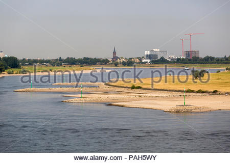 Due to persistent high temperatures and lack of precipitation, the water level of the river Rhine in Duesseldorf, Germany is lower than usual in the s - Stock Photo