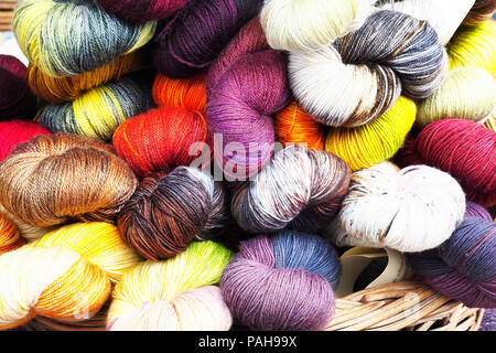 brightly coloured balls of wool - Stock Photo
