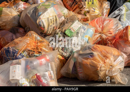 Recycling plastic waste sacks in a pile awaiting collection - Stock Photo