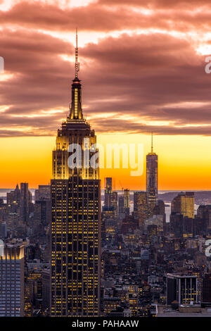 Top view at sunset of the Empire State Building with One World Trade Center in the background, Manhattan, New York, USA - Stock Photo
