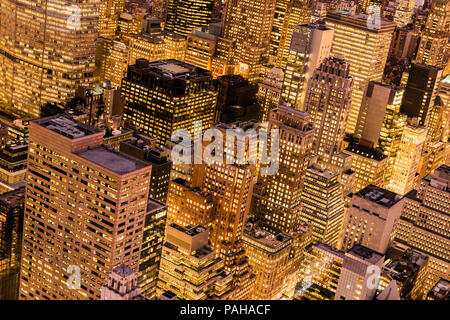 Top view by night of skyscrapers in Midtown Manhattan, New York, USA - Stock Photo