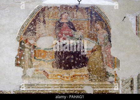 Enthroned Madonna and Child with five angels, Saint Catherine and a worshipper, fresco in the church of San Pietro Martire in Verona, Italy - Stock Photo
