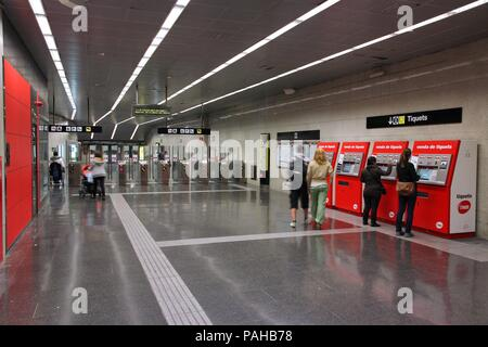 BARCELONA, SPAIN - NOVEMBER 6: People enter Metro station on November 6, 2012 in Barcelona, Spain. Barcelona has the 2nd busiest subway system in Spai - Stock Photo