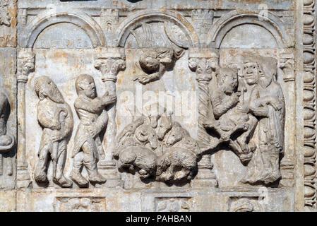 Relief of Maestro Nicolo' (12th century), group to the right of the door of the Basilica of St Zeno, UNESCO World Heritage Site, in Verona, Italy - Stock Photo