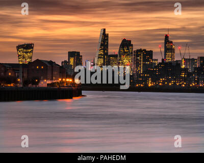 London financial city centre offices and skyscrapers towers at sunset dusk viewed along The River Thames from Canary Wharf including.... popular nickname buildings 'WalkieTalkie','Gherkin' Cheese-Grater' etc  London EC1 - Stock Photo