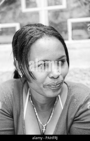 AKSUM, ETHIOPIA - SEP 30, 2011: Portrait of an unidentified Ethiopian woman with traditional pigtails in Ethiopia, Sep.30, 2011. People in Ethiopia su - Stock Photo