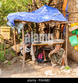 OMO, ETHIOPIA - SEPTEMBER 19, 2011: Unidentified Ethiopian man sewing. People in Ethiopia suffer of poverty due to the unstable situation - Stock Photo