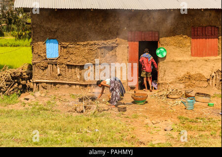 OMO, ETHIOPIA - SEPTEMBER 19, 2011: Unidentified Ethiopian near their house. People in Ethiopia suffer of poverty due to the unstable situation - Stock Photo