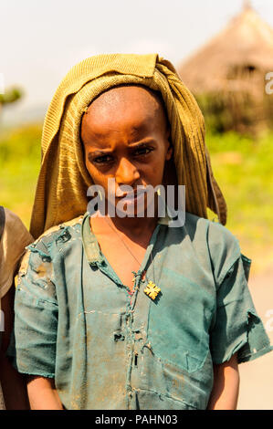 OMO, ETHIOPIA - SEPTEMBER 19, 2011: Unidentified Ethiopian boy smiles. People in Ethiopia suffer of poverty due to the unstable situation - Stock Photo