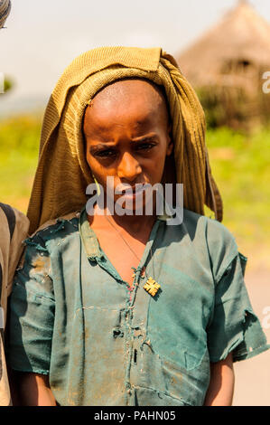 OMO, ETHIOPIA - SEPTEMBER 19, 2011: Unidentified Ethiopian boy portrait. People in Ethiopia suffer of poverty due to the unstable situation - Stock Photo