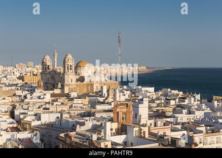 Aerial panoramic view of the old city rooftops and Cathedral de Santa Cruz in the afternoon from tower Tavira in Cadiz, Andalusia - Stock Photo