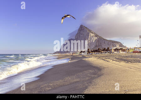 View to the rock of Gibraltar from The beach of La Linea de la concepción - Stock Photo