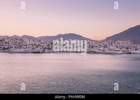 The Yacht Harbour of Puerto Banus, Andalucia, Spain on a hot summer evening. - Stock Photo