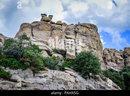 A wall of granite eroded by time and elements fashions strange and wonderful hoodoos and other land formations on the scenic byway for Mt. Lemmon in t - Stock Photo