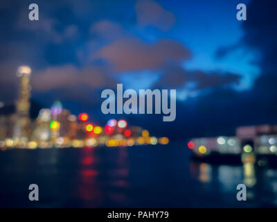 Blur image of Hong Kong night view with circle bokeh - Stock Photo