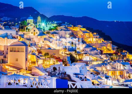 Santorini, Greece. Twilight amazing view of Oia, whitewashed city from Thira, Greek Islands. Europe holiday destination. - Stock Photo