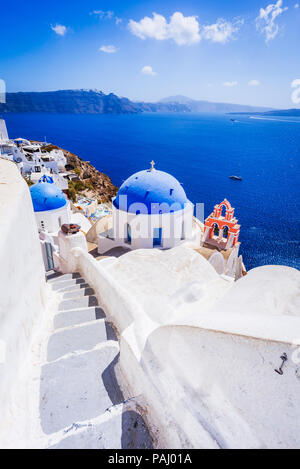 Oia, Santorini, Greece. White village with cobbled narrow paths, famous attraction of Greek Islands, Thira. - Stock Photo