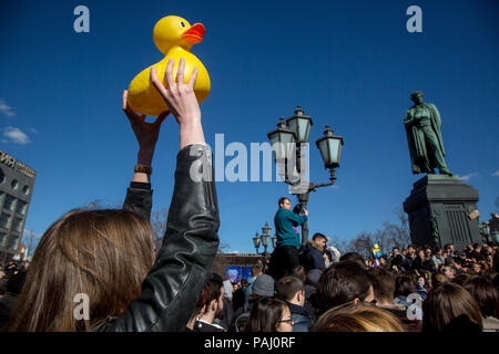 The rally participant holds a plastic duckling at an unauthorized rally against corruption in the government on Pushkin Square in Moscow, Russia - Stock Photo