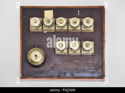 Several old fuses on a home electric board on the wall - Stock Photo